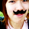 amihan: close-up image of singer yozoh with a fake mustache looking at the camera ([yozoh] moustache)
