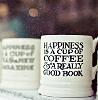 "green_dreams: Books, and coffee cup with ""Happiness is a cup of coffee and a really good book"" on the side. (coffee and a book)"