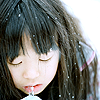 avia: A cold looking girl drinking from a straw, with snow falling into her hair. (ice girl)