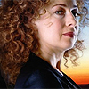 trialia: River Song, played by Alex Kingston, dark, mysterious & deadly, looking sidelong to the camera. (who] river - dark)