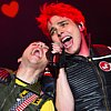 littlemousling: Photo of Gerard Way and Frank Iero in Killjoys gear, performing at Reading (Gerard & Frank)