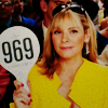 "ninamazing: Samantha from Sex and the City, holding up a ""969"" auction number sign with her characteristic owning-all smile. (i'm samantha! i have sex with everybody!)"
