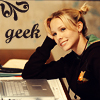 "ninamazing: Veronica Mars from Veronica Mars, with her hair in cute stub-pigtails, in front of her all-powerful Mac. Text: ""geek."" (veronica mars the gorgeous geek)"