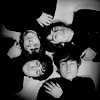 ninamazing: Black-and-white photo of all of the Beatles lying in a circle, their heads together. (the beatles:  yesterday and forever)
