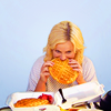 ninamazing: Leslie Knope from Parks & Recreation, biting into her favorite JJ's waffles that may be bigger than her head. (waffles friends work)