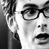 dreamtofbeing: Close-up of David Tennant, young, wearing glasses, looking surprised. (surprise)