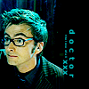 """dreamtofbeing: The tenth Doctor, wearing specs, looking interested/mellow. Captioned with """"doctor"""". (still the doctor)"""