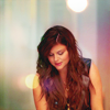 sholio: Elizabeth from White Collar, looking down, soft colored lights (WhiteCollar-Elizabeth colors)