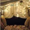 kittydesade: Stippled light shining through curtains onto a couch or bed bracketed by white pillows. (hideaway)
