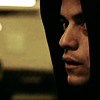 paran01d_andr01d: photo of man with hood up, looking anxiously toward viewer (Default)