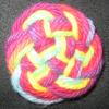 intertwined: interlaced knot of rainbow yarn (knot)