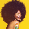 timeasmymeasure: erykah badu, shoulders bare, against a yellow background smiling at the camera (erykah: smile yellow)