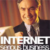 av8rmike: Man in suit at computer looking pleased, text: Internet/serious business (serious business)