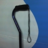 azurelunatic: A metallic blue and black horizontal-handled cane with an elastic loop at the bottom of the webbing wrist strap. (gimp, cane)