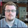 mark: Photo of Mark's face, taken in standard office fluorescent. (me)