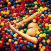theleaveswant: one bare butt between two spread legs poking out of a pool of colourful plastic balls (ball pit)