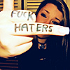 alwayswondered: A girl giving the camera the middle finger with 'Fuck haters' written on her hand. (haters gonna hate.)