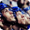leroux: Four hockey players from the Vancouver Canucks in a line, staring up in awe or concentration (Default)