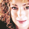 luciazephyr: Alex Kingston smiling, her curls framing her face. ([DW] spoilers)