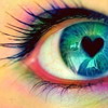 paradox: closeup of an eye with heart shaped pupil (heart)