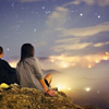 mortalcity: Two people sitting on a hill, looking at a darkening sky with stars. (stock | with your face all full of stars)