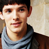 tardis_stowaway: closeup of Merlin's face with a half-smile (merlin)