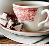 monanotlisa: a side view on a cuppa tea, white cup with red patterns, icon also has a border on the bottom like that (tea)
