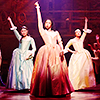 petra: Three women in US colonial garb with their arms in the air, posing like badasses (Hamilton - Schuyler Sisters)