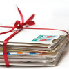 lizcommotion: Stack of letters bound with a red ribbon (snail mail)