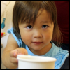 kate_nepveu: toddler offering measuring cup to person taking picture (SteelyKid - you can help too (2011-09))