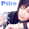 attie: Piko leaning on a table, playing with a little blue statue of two dolphins. (utaite - piko dolphins)