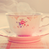 deumion: a steaming pink-and-white teacup and saucer. (Default)