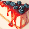 deumion: a slice of cheesecake with fruit sauce drizzled over it and running down the sides. (messy~)