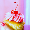 deumion: a pink cupcake topped with a large red cherry. (cherries~)
