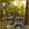 ridicully: Picture of a park with benches in autumn, camera viewfinder in the bottom right corner (Camera)