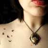 fascination: A pale woman with brown hair, with birds tattooed near to her collarbone. (Freedom's at hand.)