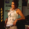 smilingslightly: Michelle Rodriguez as Letty in The Fast and the Furious, leaning up against a car (letty_tfatf)