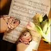 fascination: (Music and roses.)