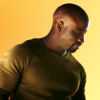 brassmama: Luke Cage from the Jessica Jones series on a yellow background (Default)