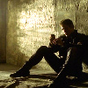 scribblesinink: John Crichton sitting on the ground, back against the wall (neutral john crichton thoughtful)