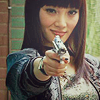 starr_falling: Pop Girl from Push holding a gun and looking smug (Crows)