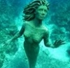 jess: underwater sculpture of a woman rising from the sea floor (Default)