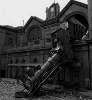mdlbear: a locomotive engine dangling from a hole in a building (trainwreck)