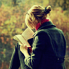 mortalcity: A blonde girl sitting in a field, holding a notebook. (OaS | Angels)