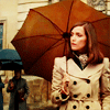 tricksterquinn: Moira MacTaggert in trenchcoat & umbrella gazing seriously out of frame. It's muted & pensive & lovely. (Moira fucking MacTaggert)