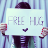 "onlysmallwings: a person holding a sign reading ""Free Hug <3"" (Quinntana Laugh)"