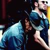 aislinn: Cougar and Jensen on their knees, cuffed (Default)