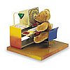 kshandra: figurine of a teddybear seated at an office desk, looking at a computer (Clefs)