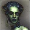 xtina: (green girl, cool-eyed)