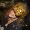 gblvr: photo of Greta wearing a gold mask and singing (THS -- Sing Greta Sing!)